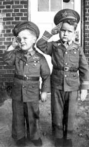 Vietnam War Congressional Medal of Honor Recipient Major Stephen W. Pless, USMC - Stephen W. Pless (left) and his brother, Travis, salute the camera in this 1942 photo.  Both boys went on to join the military as young men -- more than 20 years later, Stephen would receive the Medal of Honor for heroism during combat in Vietnam. Photo by: Courtesy of Pless family