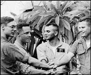 Vietnam War Congressional Medal of Honor Recipient Major Stephen W. Pless, USMC - (Left to Right) Lance Cpl. John Phelps, Maj. Stephen W. Pless, Capt. Rupert Fairfield, and Gunnery Sgt. Leroy Poulson, pose for a photo in Da Nang, Vietnam, following their daring rescue mission.  Pless was awarded the Medal of Honor for his actions, and all other members of his crew received the Navy Cross. Photo by: Official U.S.M.C. Photo from Pless Archives